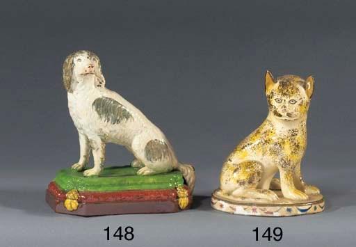 A pottery model of a lion cub