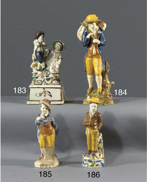 A Prattware figure of a young