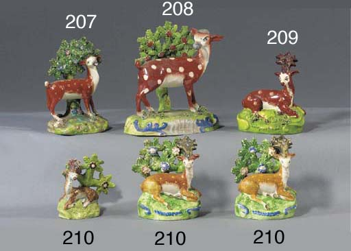 Two pearlware models of stags
