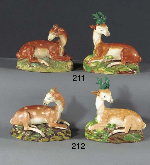 Two pearlware model of deer
