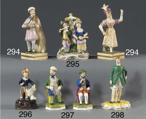 A pair of porcelain figures of