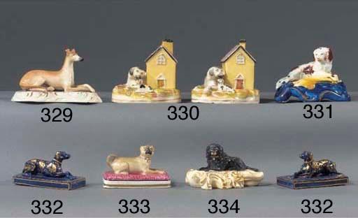 A porcelain model of a pug