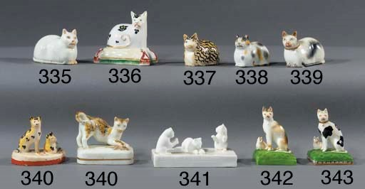 A pottery group of two cats