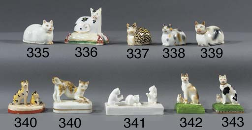 A porcelain model of a cat and