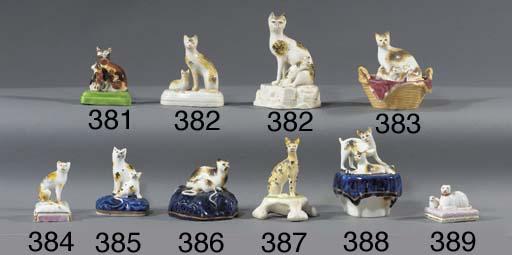 A porcelain model of a cat