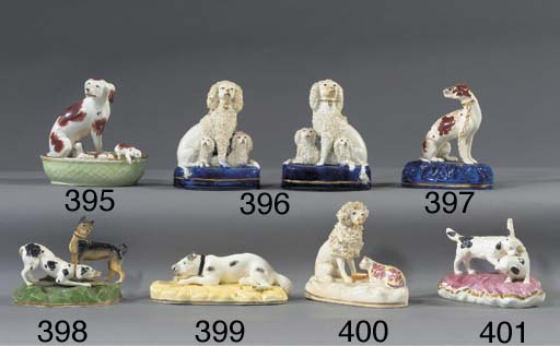 A porcelain group of two dogs