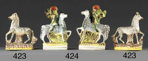 A pair of models of zebras