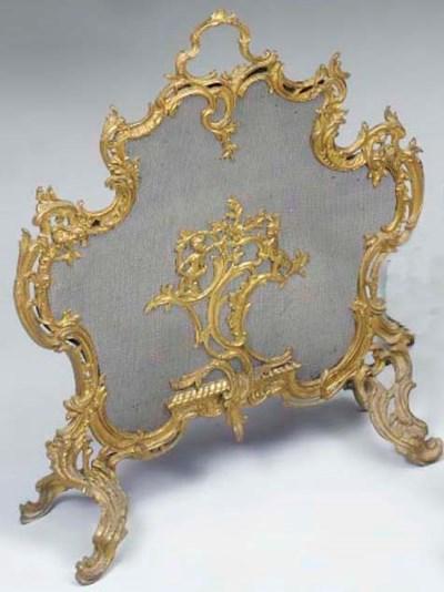 A gilt brass fire-screen of ca