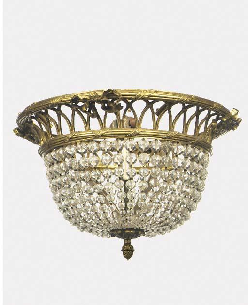 A gilt brass and glass bead hu