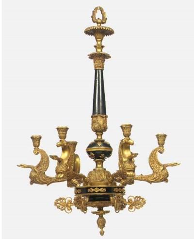A gilt metal and ebonised wood