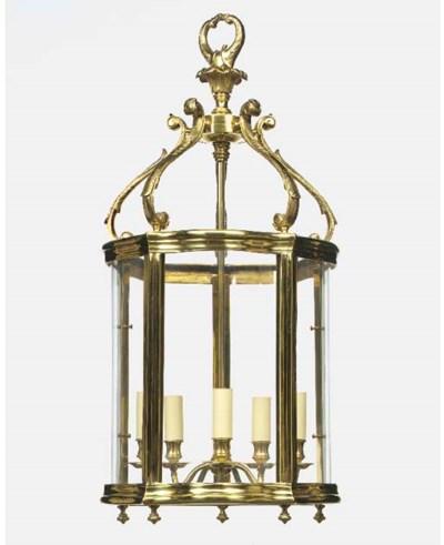 A brass and glazed pentagonal
