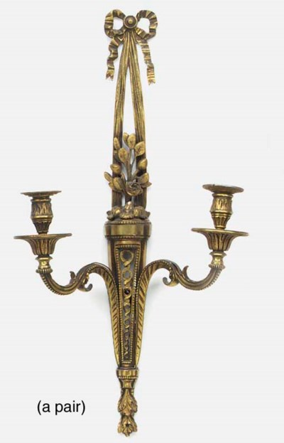 A pair of gilt brass twin ligh