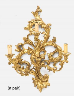 A pair of carved gilt wood and