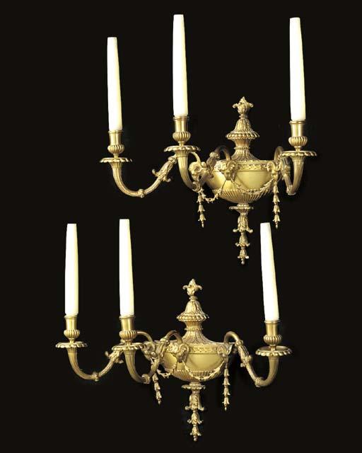 A set of four gilt metal three light wall appliques, 20th century