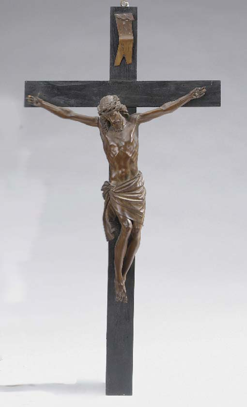 A South European carved olive wood and ebonised Corpus Christi, late 19th or early 20th century