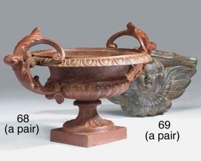 A pair of cast iron urns, Fren