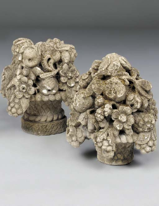 Two carved stone pier finials,