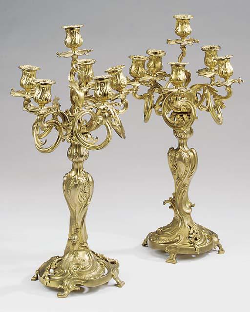 A pair of gilt bronze six ligh
