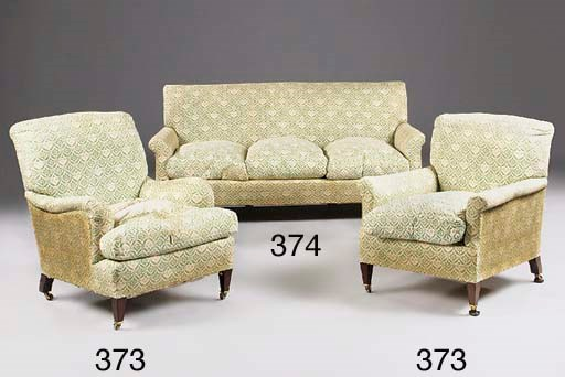 A pair of Howard armchairs, fi