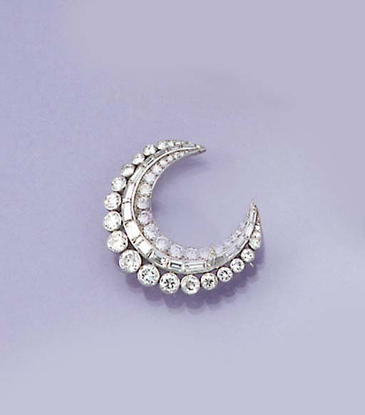 A diamond crescent brooch reta