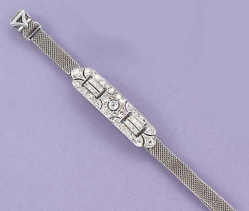 An Edwardian diamond and rose-