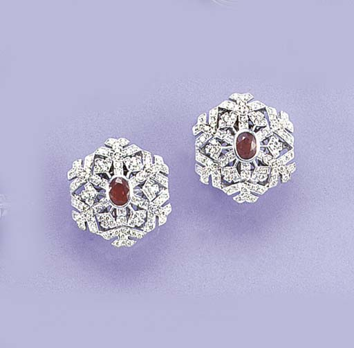 A pair of ruby and diamond sno