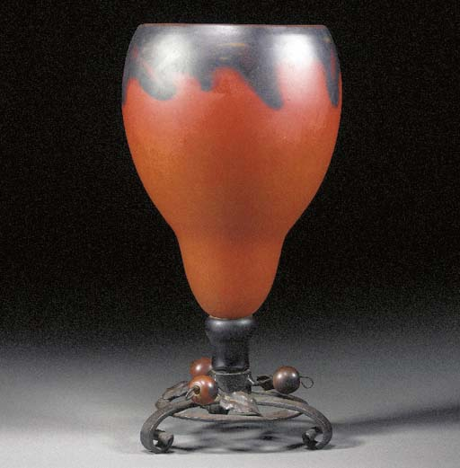 A GLASS AND WROUGHT-IRON VASE