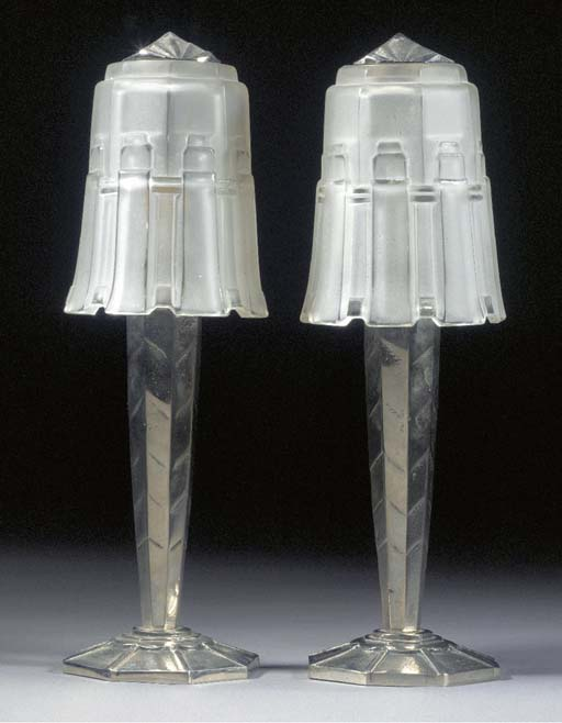 A PAIR OF SILVERED METAL AND F
