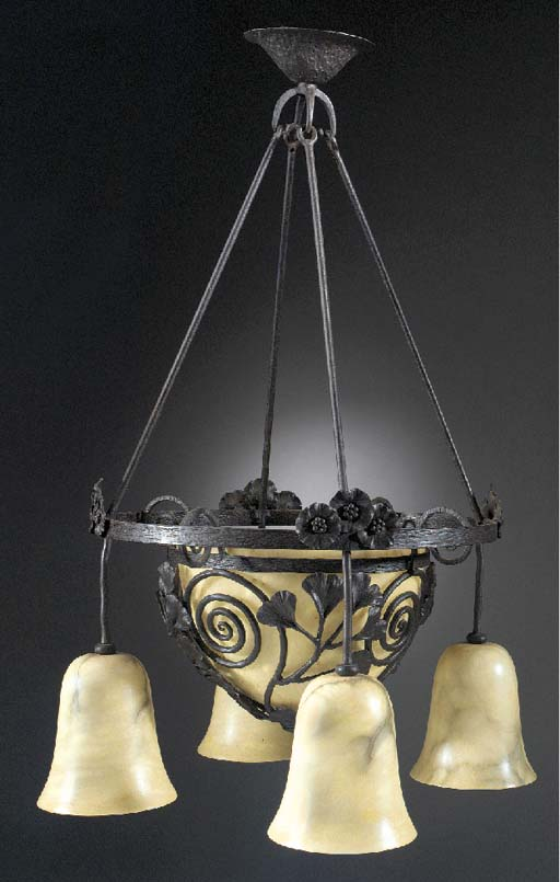 A WROUGHT-IRON AND ALABASTER C