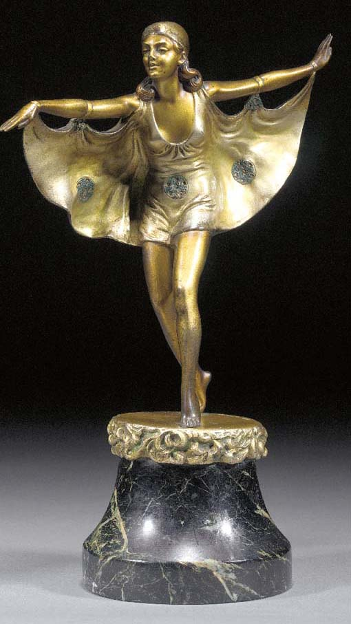 'BAT-WING GIRL' A GILT AND COL
