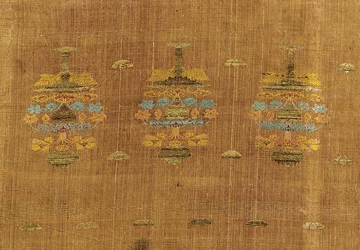 A panel of buff coloured silk,