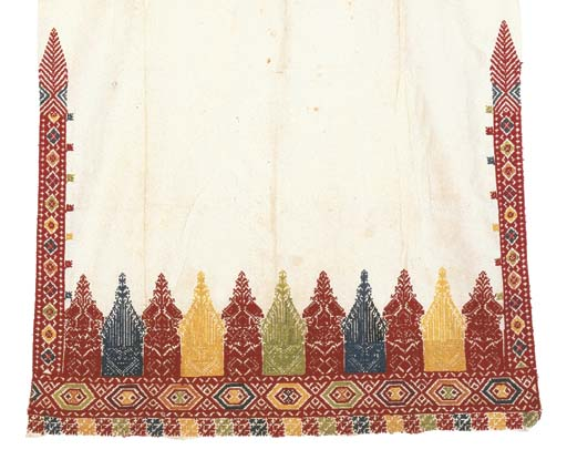 An embroidered bolster cover,