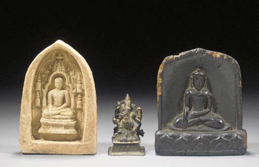 A Tibetan wood carved seated b