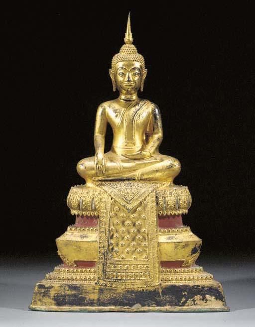 A Thai lacquered and gilt bron
