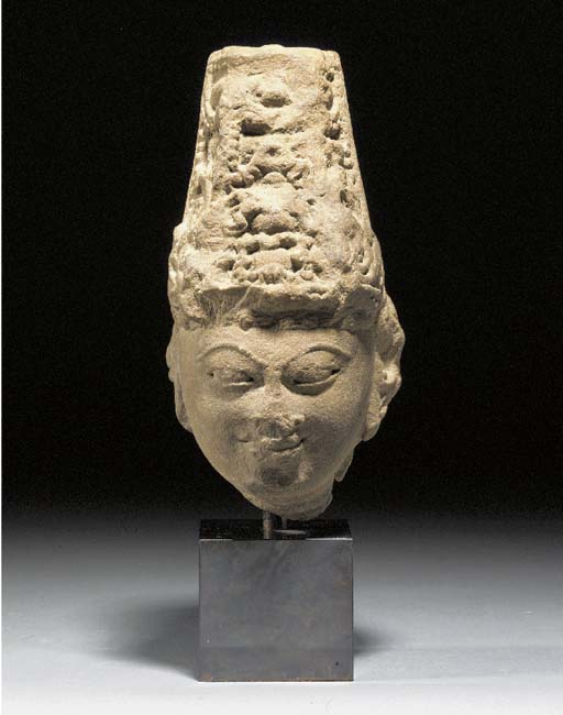 A Central Indian sandstone head of a deity 10th/12th Century A.D.
