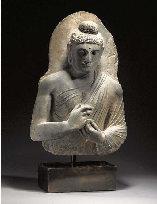 A grey schist bust of Buddha G