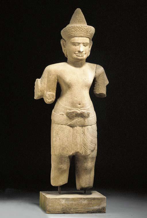 A large stone figure of a deit