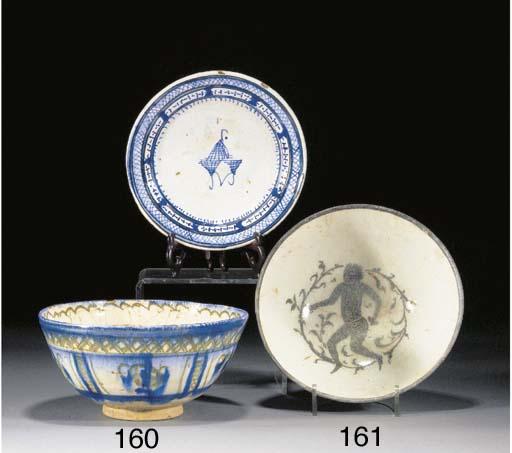 A Persian deep pottery bowl