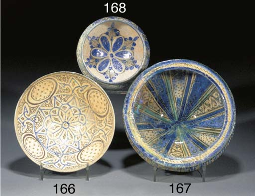 A Kashan tapering pottery bowl