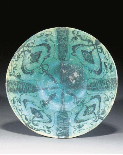 A Kashan deep flaring pottery bowl 12th century