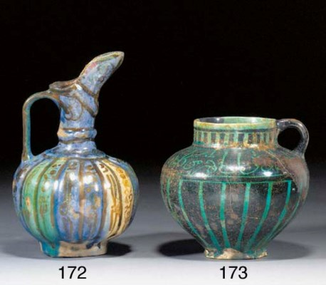 A Kashan turquoise and dark bl