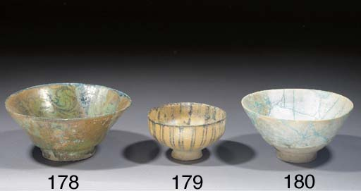 Five Kashan or Nishapur turquoise glazed pottery bowls 13th century