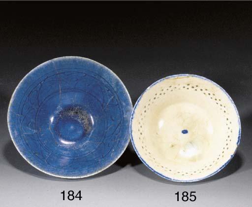 A Nishapur blue glazed flaring