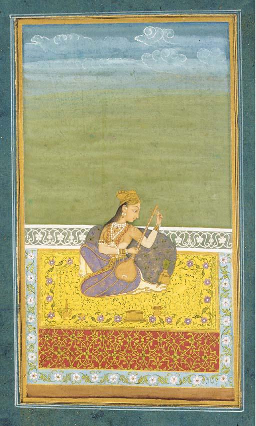 A lady Tuning a Tampura Rajast