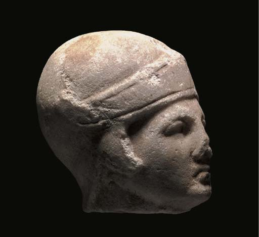 A ROMAN MARBLE HEAD OF A WARRI