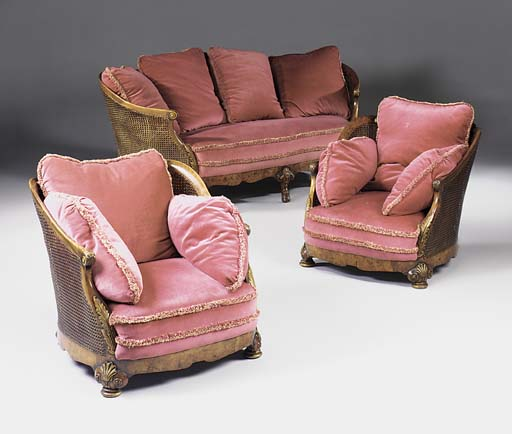 A three piece walnut and burr walnut bergere suite, early 20th century