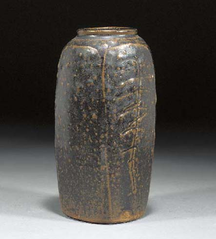 A stoneware cut-sided vase