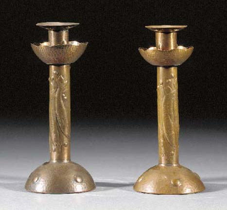 A pair of Newlyn copper candle