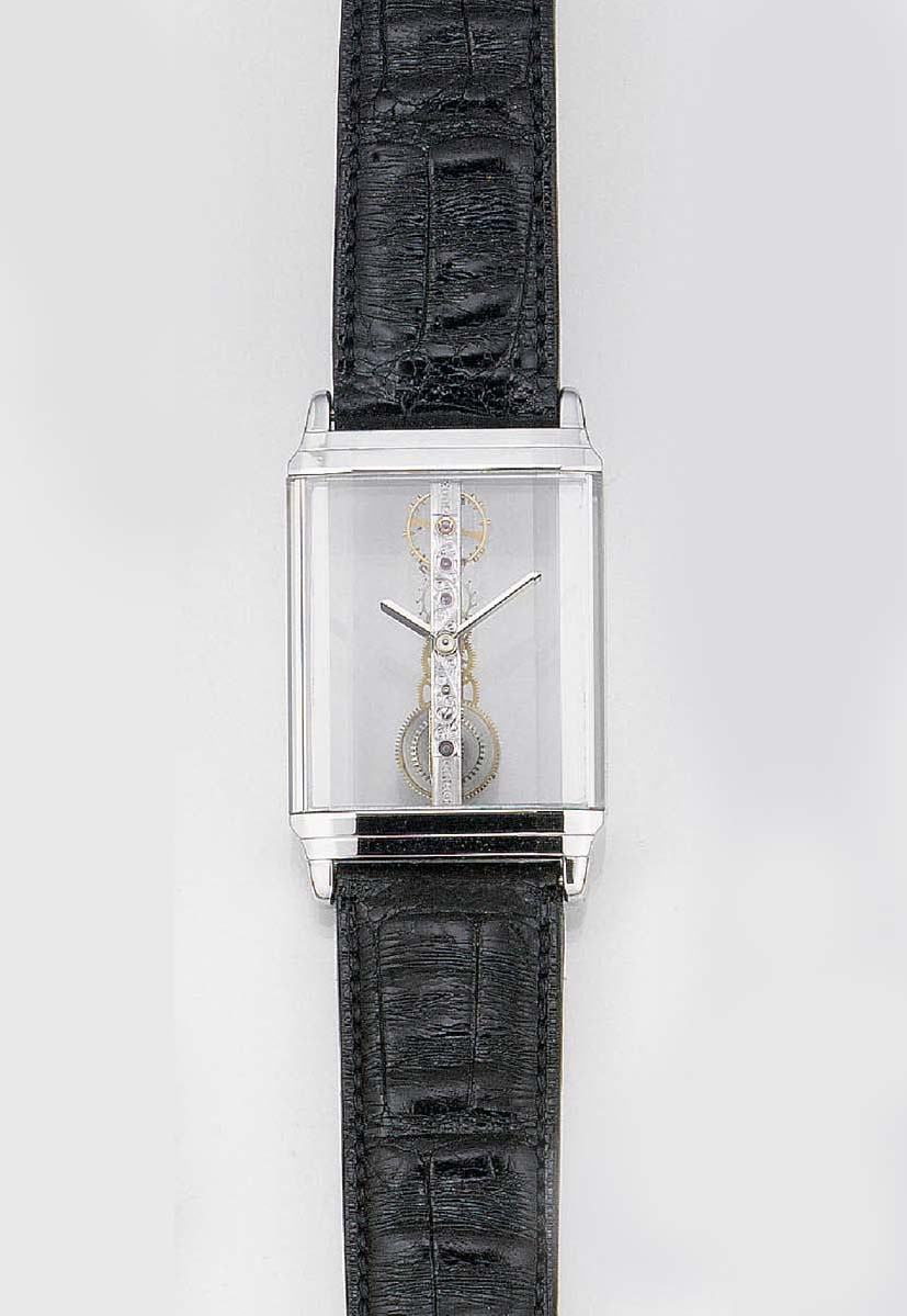 CORUM, AN 18ct. WHITE GOLD AND