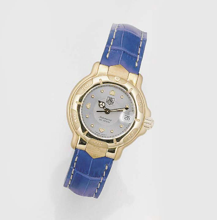 TAG HEUER, A LADY'S 18ct. GOLD